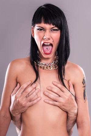 naked female body: Attractive Tattoo Girl. Naked female body covered with manly hands.