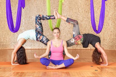 Yoga practicing. Women practicing yoga at health club photo