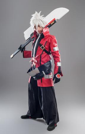 Manga hero with sword. A young man dressed in comic style superhero Zdjęcie Seryjne
