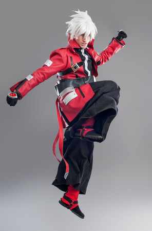 fanatic studio: Manga hero with sword. A young man dressed in comic style superhero Stock Photo