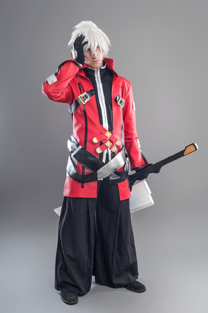 cosplay: Manga hero with sword. A young man dressed in comic style superhero Stock Photo