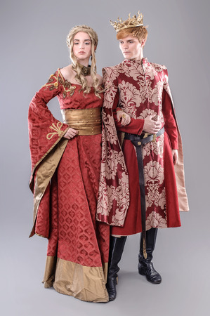 costumes: Models dressed in medieval theme.