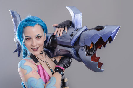 Fantasy Action Hero. Jinx the loose cannon league of legends. Models dressed in their favorite heroes. photo