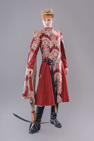 Medieval King.  Medieval king with sword and crown. Joffrey Lannister.