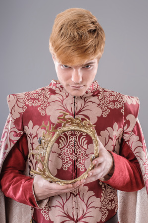 queen's theatre: Medieval King.  Medieval king with sword and crown. Joffrey Lannister.