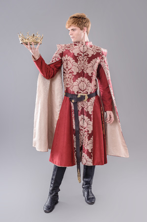 historical clothing: Medieval King.  Medieval king with sword and crown.