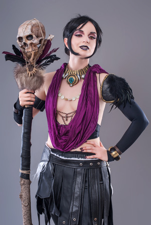 Dark gothic woman. Sexy gothic woman posing with skull. photo