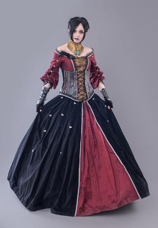 gothic woman: Dark gothic woman. Sexy gothic woman posing in studio. Stock Photo