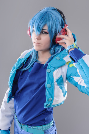 cosplay: Girl with Headphones.  Attractive young woman listening to music on her headphones