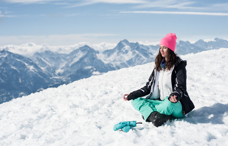 les: Beautiful young woman doing yoga in the snow mountains Winter Scenic in the French Alps, Les 2 Alpes