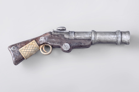 flintlock: Flintlock pistol isolated on the gray background