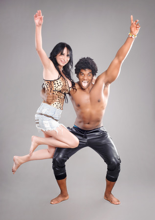 attractive female: Passionate couple.  Young and sexy passionate couple on gray studio background