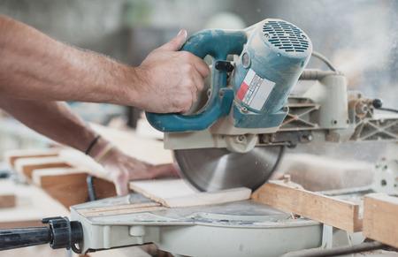 carpenter: Circular Saw.  Carpenter Using Circular Saw for wood