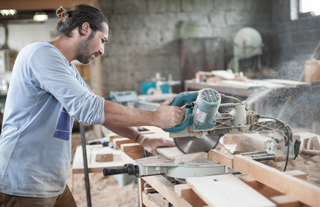 circular saw: Circular Saw.  Carpenter Using Circular Saw for wood
