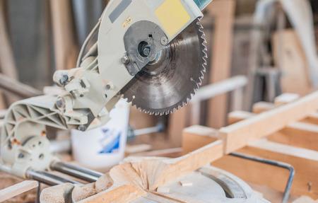 carpenter: saw, circular, power, industry, wood, machine, man, carpenter, lumber, people, crafting, furniture, workshop, work, worker, carpentry, background, equipment, construction, cut, board, tool, craft, timber, plank, machinery, craftsman, woodwork, sawing, ele