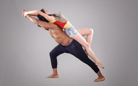 hot guy: Passionate couple.  Young and sexy passionate couple on gray studio background