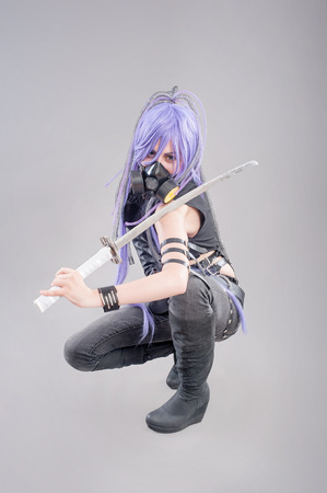 Female fantasy warrior. Female warrior with sword and gas mask isolated on the gray background