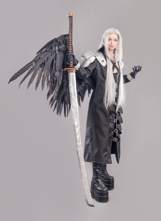 woman with sword: Fantasy woman warrior. Woman warrior with sword and wings isolated on the gray background