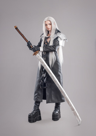 Fantasy woman warrior Woman warrior with sword and armor isolated on the gray background