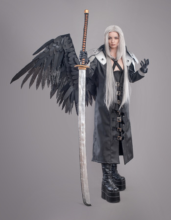 warrior girl: Fantasy woman warrior Woman warrior with sword and wings isolated on the gray background