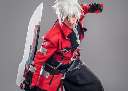 cosplay: Manga hero with sword A young man dressed in comic style superhero
