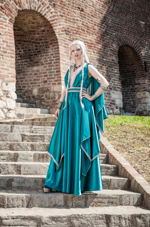 century: Woman In Medieval Times. Beautiful woman posing on the fortress