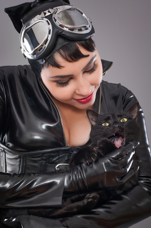 catwoman: catwoman. Beautiful woman in catwoman leather latex whith whip