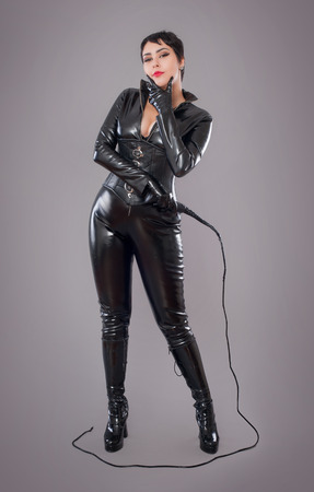 latex: catwoman. Beautiful woman in catwoman leather latex whith whip