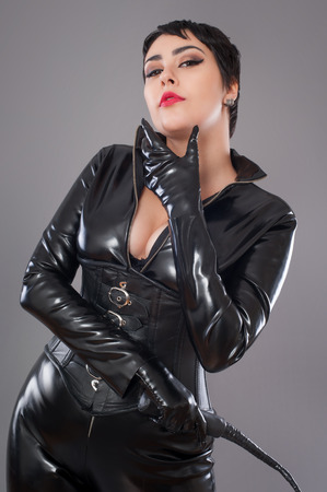 catwoman. Beautiful woman in catwoman leather latex whith whip