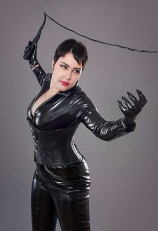 latex woman: catwoman. Beautiful woman in catwoman leather latex whith whip