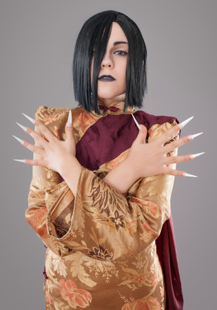 gothic woman: Gothic woman with chinese nails. Dark gothic woman with cloak and chinese nails