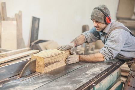 Circular Saw.  Carpenter Using Circular Saw for wood
