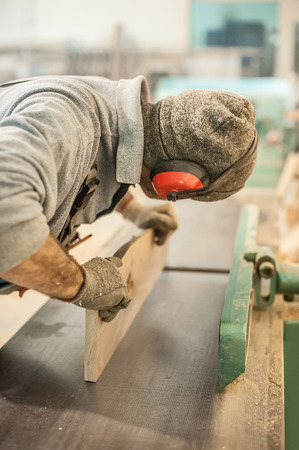 workroom: Carpenter using belt sander. Carpenter sanding a wood with belt sander