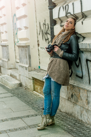obscured face: Female Tourist Photographer. Pretty young female tourist photographer taking pictures in the city