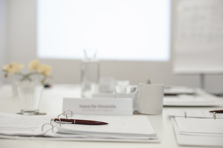 place of work: Business work place with pen and papers on the table