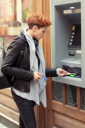 pin entry: Business  woman withdrawing money from credit card at ATM Stock Photo