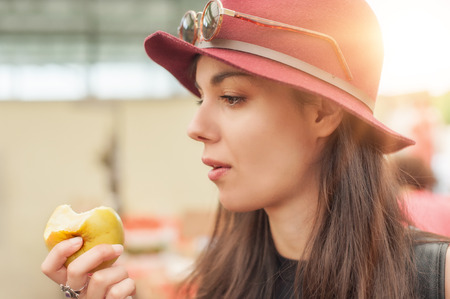 weekly market: A young woman buying fruits and vegetables at a weekly market. Stock Photo