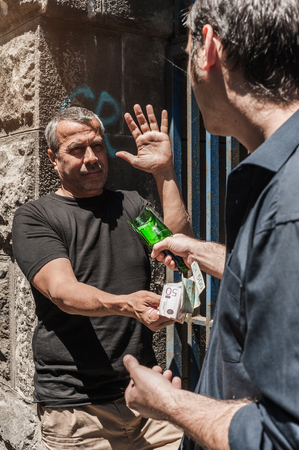 rowdy: Bully with a broken bottle taking money from victim in a abandoned part of the city