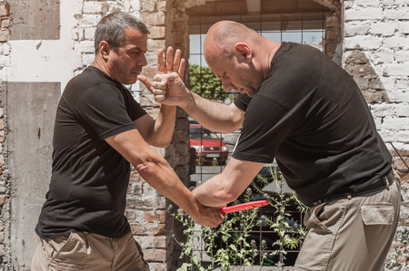 techniques: Kapap instructor demonstrates self defense techniques against a knife attack