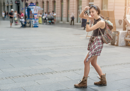 obscured face: Pretty young female tourist taking pictures in the city Stock Photo