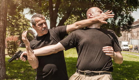 Kapap instructor demonstrates self defense techniques against a gun Stock Photo