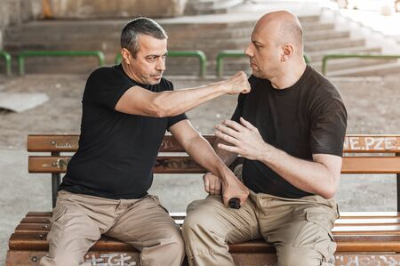 techniques: Kapap instructor demonstrates self defense techniques against a gun Stock Photo