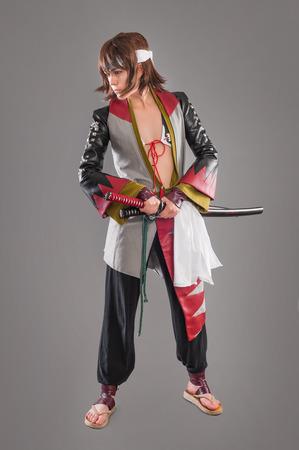 katana: Japanese samurai with katana sword. Studio shoot. Isolated.