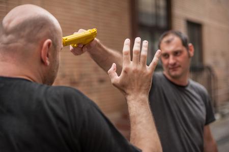 attacker: Kapap instructor demonstrates self defense techniques against a gun Stock Photo