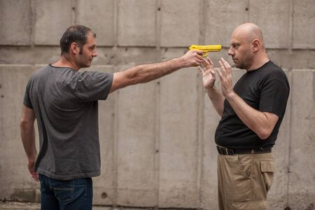 disarm: Kapap instructor demonstrates self defense techniques against a gun Stock Photo