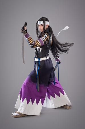 Japanese samurai with katana sword. Studio shoot. Isolated Reklamní fotografie