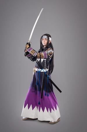 Japanese samurai with katana sword. Studio shoot. Isolated Stock Photo