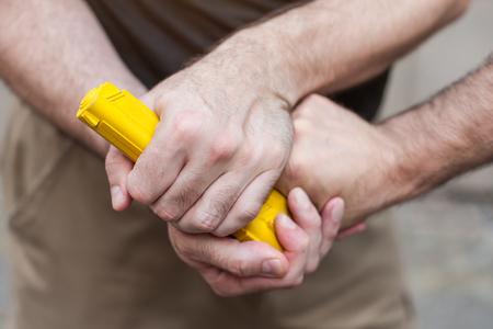 Kapap instructor demonstrates self defense techniques against a gun point. Gun Disarm.