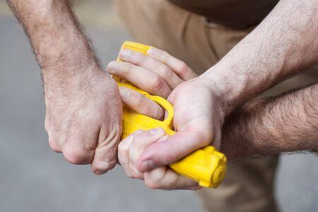 attacker: Kapap instructor demonstrates self defense techniques against a gun point. Gun Disarm.