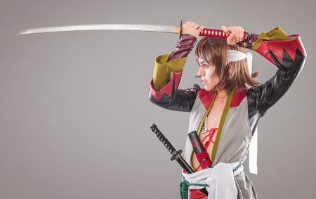 katana: Japanese samurai with katana sword. Studio shoot. Isolated Stock Photo